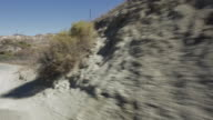 POV A rocky mountain landscape shot from moving vehicle / Santa Clarita, California, United States