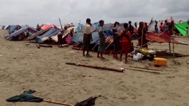 Rohingya Muslims who fled their homes in western Myanmar's Rakhine state due to the ongoing operations conducted by Myanmar's security forces arrive...