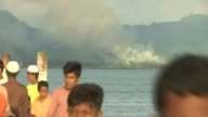 Rohingya refugee crisis / Aung San Suu Kyi makes first speech 1492017 Children watching plume of smoke rising from Rohingya village across stretch of...