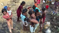 Rohingya Refugee kids collect water from tubewell in Balukhali Refugee camp Cox's Bazar Chittagong Bangladesh September 16 2017 Aung San Suu Kyi said...