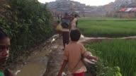 Rohingya Refugees walk through muddy roads in the Balukhali Refugee camp Cox's Bazar Chittagong Bangladesh September 15 2017 Aung San Suu Kyi said...