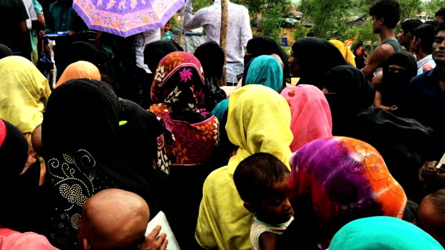 Rohingya wait in line for hours as an emergency food distribution takes place by World Food program and Save The Children October 7 Kutupalong Cox's...