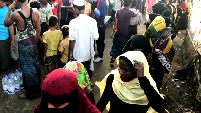 Rohingya wait in line for local supplies of food and drink October 7 Kutupalong Cox's Bazar Bangladesh Rice lentils sugar salt and oil was given out...