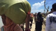 A Rohingya woman talks to his relatives on mobile phone after reaching bangladesh by boat Shahpirer dip Bangladesh September 14 2017 Aung San Suu Kyi...