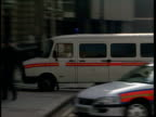 Refused bail ITN ENGLAND London Bow Street Police van bringing Roisin McAlisky to court thru gates as armed police on streets Supporters of McAliskey...