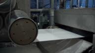 Roller machine reeling filament in factory