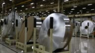 Rolls of sheet aluminum sit on the production line manufacturing vehicle heaters and air conditioners at the Halla Visteon Climate Control Corp plant...
