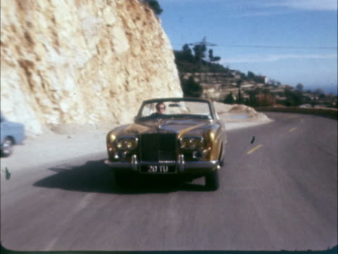Nicholson driving bronze Rolls FRANCE Nice 'Grand Corniche' Road MS Mike Nicholson drives bronze Rolls towards on a mountain road