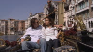 MS, Romanic couple in gondola, Venice, Italy