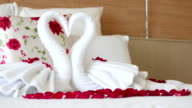 HD Romantic bedroom setup with towel and rose