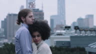 Romantic couple on rooftop in New York