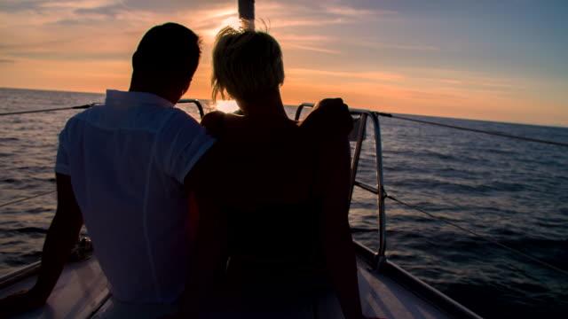 MS Romantic Couple Sailing At Sunset