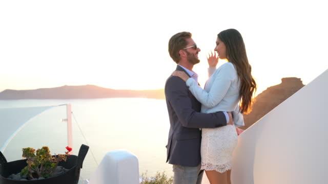 romantic rich couple sunset greece