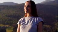 Romantic woman enjoying sunset in mountains