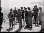 Rommel and Kesselring confer meet outside with other officers map of german advances in the Middle East