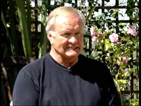 Ron Atkinson says he isn't a racist ITN Austin and Ron Atkinson walking in garden Austin asking question Ron Atkinson interview SOT It wasn't a...
