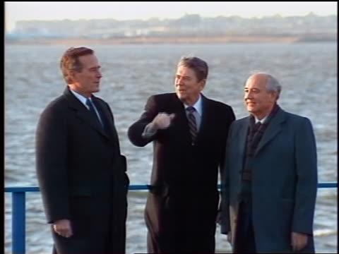 Ronald Reagan George Bush Mikhail Gorbachev interpreter waving pointing outdoors / Lower Manhattan New York USA