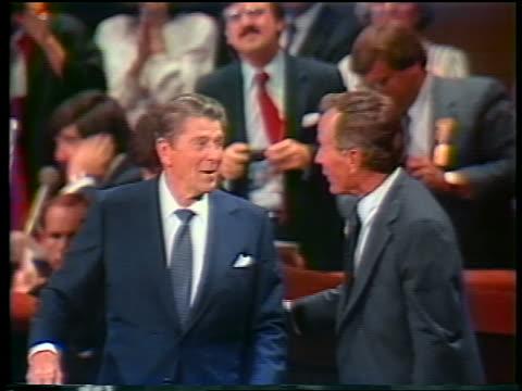 Ronald Reagan George Bush talking waving at Republican National Convention / Dallas