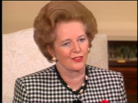 Ronald Reagan Margaret Thatcher sit next to each other at press conference