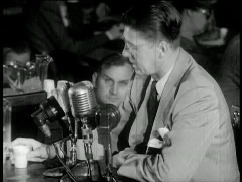 Ronald Reagan with eyeglasses testifying at HUAC hearings / newsreel