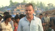 Ronhingya refugee crisis worsens BANGLADESH EXT Reporter to camera Eric Schwartz interview SOT CUTAWAYs Rohingya refugees along some with sacks of...