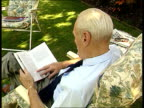 Jack Slipper sitting reading his book on Ronnie Biggs Jack Slipper intvwd doesn't think anything will be achieved by bringing Biggs back