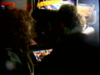 Ronnie James Dio and other Dio band members play Asteroids video arcade game Dio band members playing video arcade game on January 23 1983 in Tarzana...