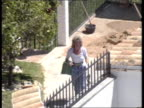 Ronnie Knight Extradition SPAIN Malaga SEQ Builders at Knight's villa/ wife Sue along SEQ Palace of Justice/ 'Palacio de Justicia' SEQ Knight's...