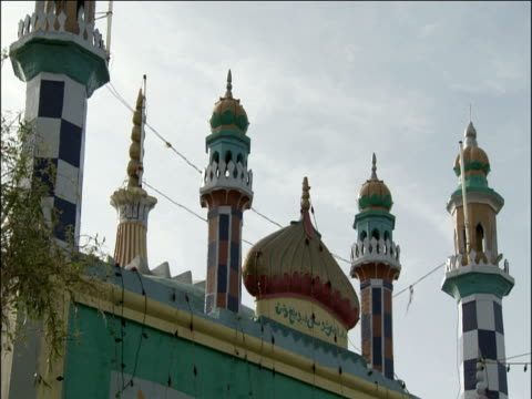 Roof of brightly coloured highly decorated Muslim shrine Pakistan