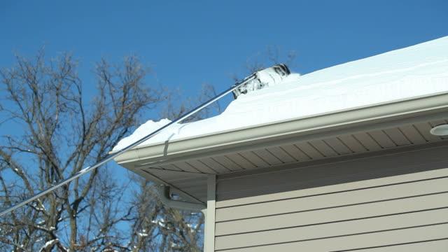 Roof Rake Removing Winter Snow