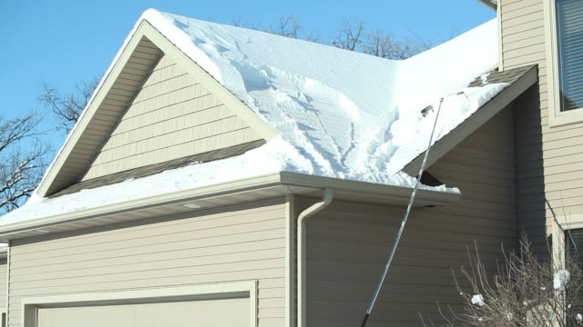 Roof Rake Removing Winter Snow