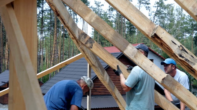 Roofers work on the roof.