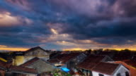 WS T/L rooftops with stormy sky at sunset / Hoi An, Quang Nam, Vietnam