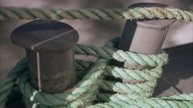 A rope tied around bitts Stockholm archipelago Sweden.