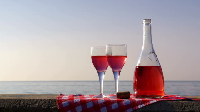 Rosé wine pour at the beach