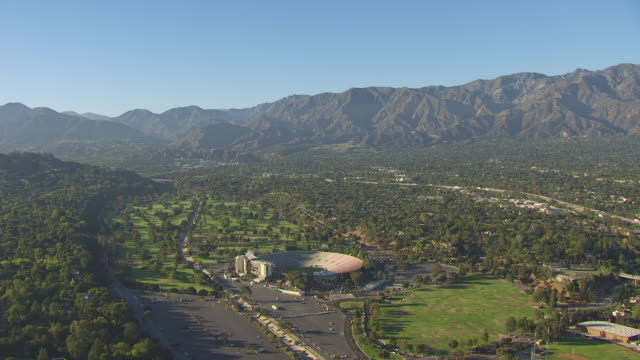 WS AERIAL POV Rose Bowl stadium with Green Landscape at Pasadena, California