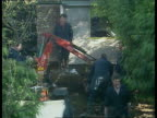 Day 31 Verdicts LIB March 1994 Cromwell St No25 TLMS Police with small digger searching garden TCMS Paving slab lifted TMS Policeman inspecting find