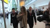 Rosie HuntingtonWhiteley flys into London Heathrow accompanied by two British Airways staff SIGHTED Rosie HuntingtonWhiteley at Terminal Five on June...