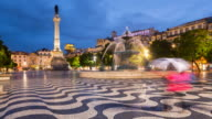 TL WS Rossio Square Lisbon in the rain at night