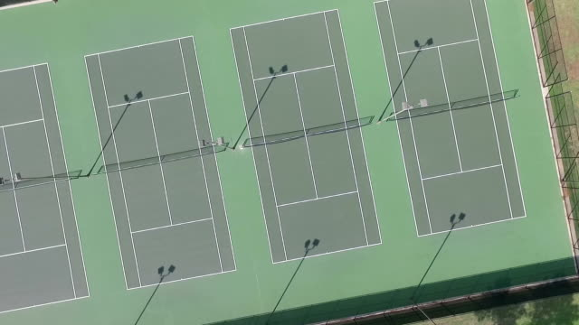 Rotating video of tennis courts from straight above
