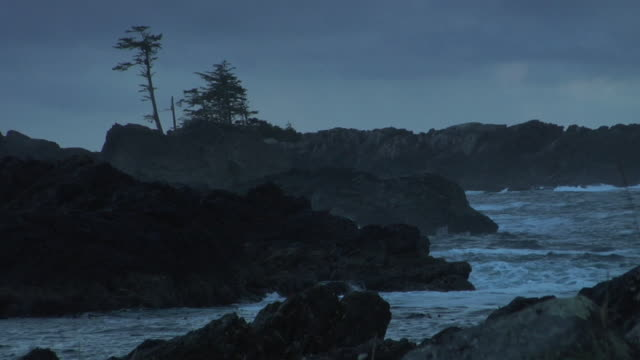 SLO MO WS Rough ocean waves crashing against rocky coastline at dawn, Ucluelet, British Columbia, Canada