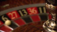 A roulette wheel spins, and the ball lands on 6.