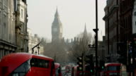Routemaster buses and other traffic pass by at Whitehall in London
