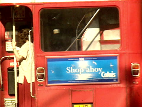Routemaster buses pass each other on Oxford Street 1998