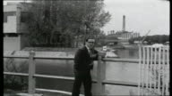 Billancourt FRANCE Billancourt EXT General view River Seine Reporter to camera with river and state owned Renault factory on Seguin Island in...