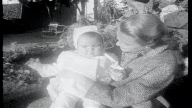 Birthday Album MONACO Princess Grace with baby daughter Princess Caroline in garden Citroen car along snowy road past woods driven by ITN film...