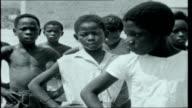 Congo Countdown EXT Boys in school yard Teacher giving instructions to boys in gym class Boys doing exercises Belgian teacher teaching older...