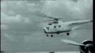 Congo Countdown Title sequence CONGO Leopoldville EXT ONU helicopter taking off General Joseph Mobutu Mobutu boarding plane Map of Republic of the...