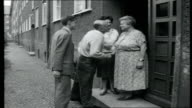 Crisis In Berlin SEQUENCE reporter through border at Friedrichstrasse in car with British family the Normans East Berlin Reporter introduced to...