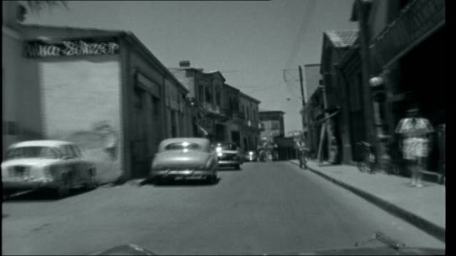 Cyprus [trailer only] CYPRUS Nicosia Narrow street seen from DRIVER POINT OF VIEW then stopping at barbed wire marking the socalled 'MasonDixon line'...